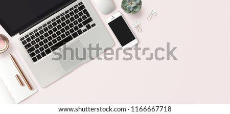 bright feminine banner / header with a stylish workspace with laptop computer, smartphone modern office accessories and a small succulent on a blush table, top view / flat lay Royalty-Free Stock Photo #1166667718