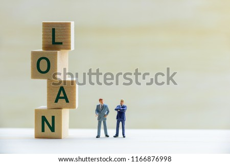 Financial loan negotiation / discussion among a lender and borrower concept : Miniature figurine two businessmen talk on money loan contract agreement, discuss about a company credit and loan profile Royalty-Free Stock Photo #1166876998