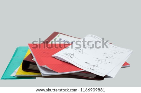 stack of homework, mathematics task, books, file, booklet and white background Royalty-Free Stock Photo #1166909881