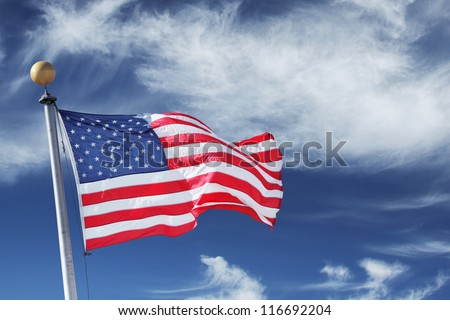 USA. Windblown flag of the United States of America over sky background. #116692204