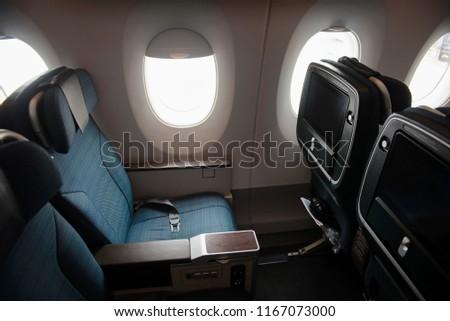 Empty aircraft premium economy class seats and windows #1167073000