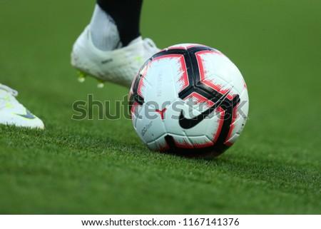 AUGUST 11, 2018 - KHARKIV, UKRAINE: NIKE MERLIN 2018-2019 SOCCER BALL. Close-up detailed view of legs with Nike boots dribbling the ball. Ukrainian Premier League. Shakhtar Donetsk - Vorskla Poltava #1167141376