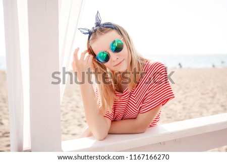 One beautiful teenage girl with brown hair outside on a beautiful summer day. idea and concept of beach holidays, vacations, freedom from school #1167166270