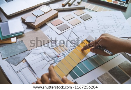 Architect designer Interior creative working hand drawing sketch plan blueprint selection material color samples art tools Design Studio #1167256204