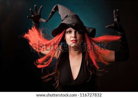 Witch practises witchcraft on black background. #116727832
