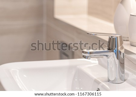 Bathroom tap at the sink #1167306115