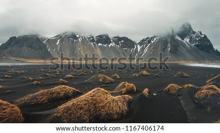 Stokksnes cape and Vestrahorn Mountain. Landscape with popular tourist attraction in Iceland. Exciting excursion to the sights view in winter #1167406174