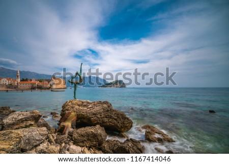 Budva, Montenegro - April 2018 :  The statue of Ballerina Dancer, standing on the rock, Budva landmark, Montenegro #1167414046