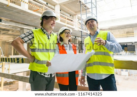 Group of engineers, builders, architects on the building site. Construction, development, teamwork and people concept. #1167414325