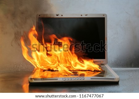 Laptop Damage. Laptop on fire and flames. Computer Repair. Flaming Fire laptop computer.   #1167477067
