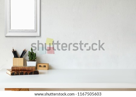 Mockup workspace vintage books, dry flower, office stationery and poster frame #1167505603