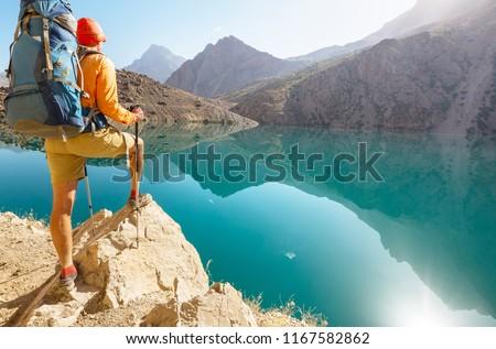 Wanderlust time. Man hiking in beautiful Fann mountains in Pamir, Tajikistan. Central Asia. #1167582862