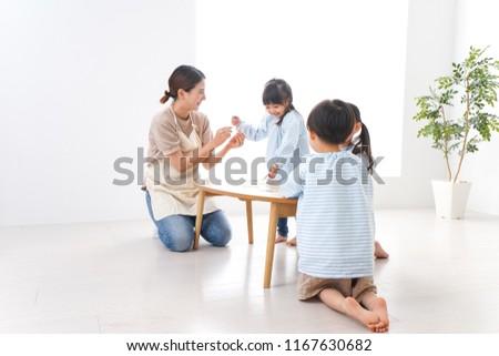 Children's nurse and kindergarten children #1167630682