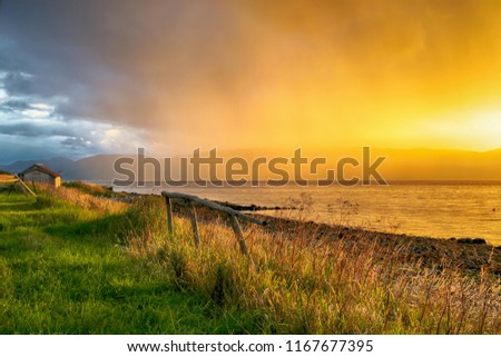 Trondheim fjord, sea coast and finishing barn during colorful summer sunset  #1167677395