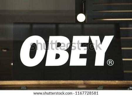 Swindon, Wiltshire, UK Aug 2018. Obey logo close up, isolated on dark background. #1167728581