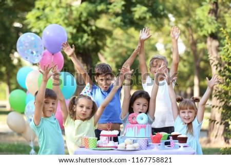 Cute little children celebrating Birthday outdoors #1167758821