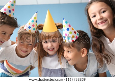 Portrait of cute little children in Birthday hats indoors #1167758839