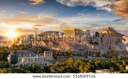 The Acropolis of Athens, Greece, with the Parthenon Temple on top of the hill during a summer sunset #1168009126