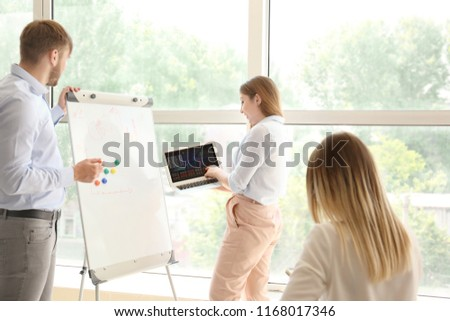Young man giving presentation during business meeting #1168017346