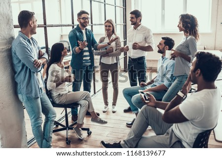 Group of Young Business People on Break in Office. Successful Business Team Talking on Coffee Break. Young Smiling Colleagues on Break Drinking Coffee Chatting in Modern Office. Corporate Lifestyle #1168139677