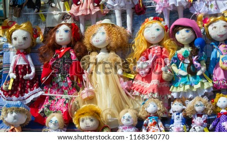 Flea market,  folk crafts. Handmade rag dolls. A rag doll is a children's toy. It is a cloth figure, a doll traditionally home-made from (and stuffed with) spare scraps of material. #1168340770