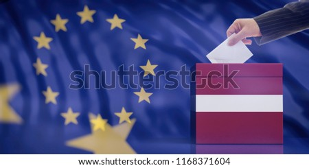 Elections in Latvia for EU parliament. Hand inserting an envelope in a Latvian flag ballot box on European Union flag background. 3d illustration #1168371604