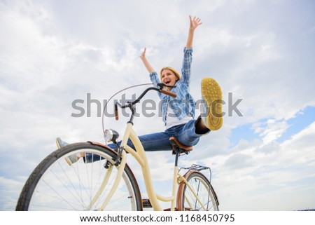 Cycling gives you feeling of freedom and independence. Girl rides bicycle sky background. Freedom and delight. Woman feels free while enjoy cycling. Most satisfying form of self transportation. #1168450795
