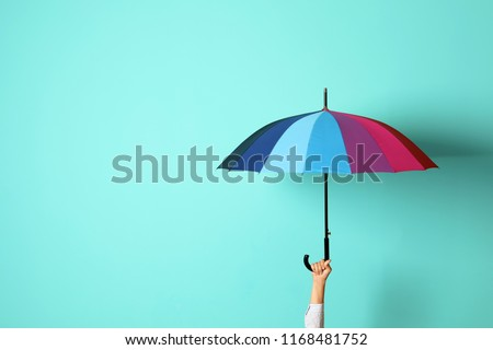 Woman holding beautiful umbrella on color background with space for design #1168481752