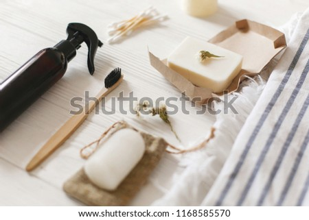 natural eco bamboo toothbrush, coconut soap, handmade detergent, crystal deodorant, bamboo ear sticks on towel, bathroom essentials in sustainable lifestyle. zero waste concept #1168585570