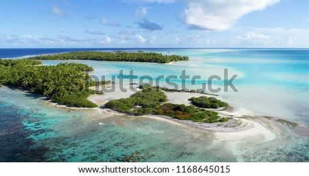 small islands (motu) in the middle of a lagoon in aerial view, French Polynesia #1168645015