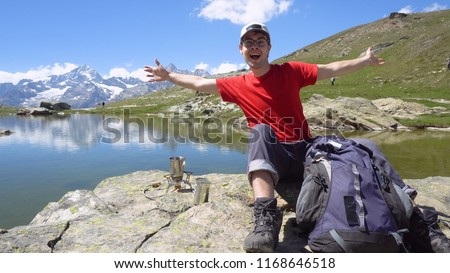 Smiling Active Young Man in Outdoors The Mountains