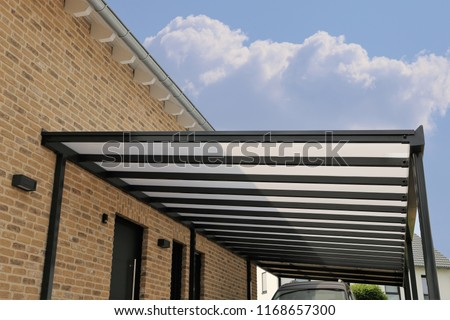 Courtyard canopy with glass Royalty-Free Stock Photo #1168657300