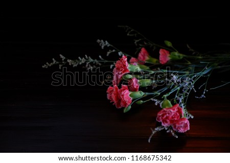 boutique flower on vintage wooden background #1168675342