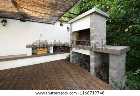 Modern outdoor kitchen covering with resin #1168719748