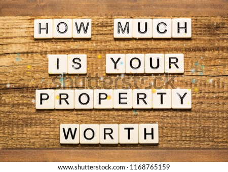 Business man pointing to transparent board with text: How Much is your Property Worth? #1168765159