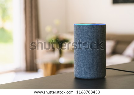 voice controlled smart speaker Royalty-Free Stock Photo #1168788433