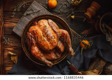 Homemade roasted chicken on a rustic wooden background. Close up. Top view #1168835446