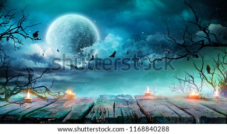 Halloween Background  - Old Table With Candles And Branches At Spooky Night With Full Moon  #1168840288