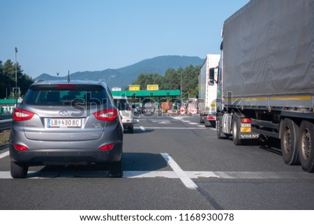 Highway A1, near Vransko, Slovenia - 29 August 2018 - Cars standing still before toll station Vransko on highway, a car accident caused traffic jam on the busiest highway in Slovenia between Maribor #1168930078