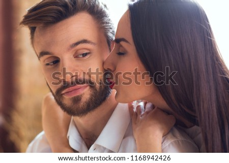 Young couple having romantic evening at home woman reading book #1168942426