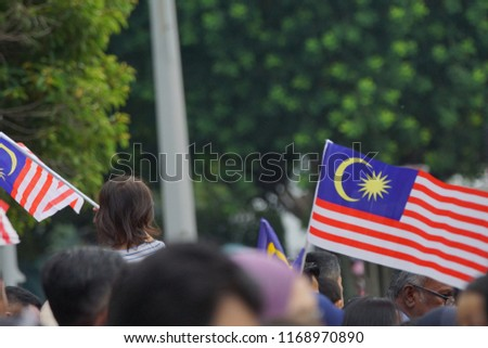 PUTRAJAYA, MALAYSIA - 31 August 2018: Merdeka Day celebration is a colorful event and is held in commemoration of Malaysia's Independence Day at Dataran Putrajaya. Image contain certain grain or noise #1168970890
