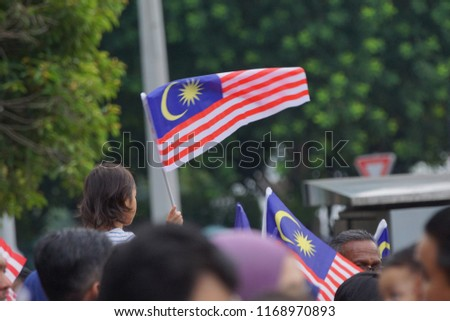 PUTRAJAYA, MALAYSIA - 31 August 2018: Merdeka Day celebration is a colorful event and is held in commemoration of Malaysia's Independence Day at Dataran Putrajaya. Image contain certain grain or noise #1168970893