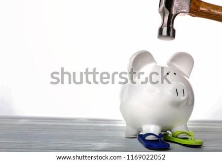 Piggy bank and hammer #1169022052
