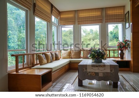 brown roman blind shade curtain tree forest mountain background living room Royalty-Free Stock Photo #1169054620
