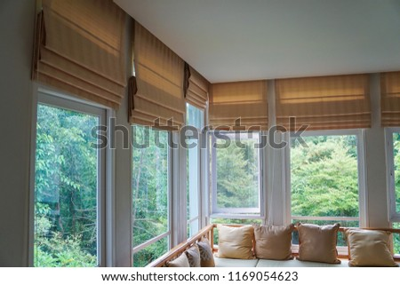 brown roman blind shade curtain tree forest mountain background living room Royalty-Free Stock Photo #1169054623