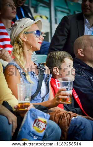 TALLINN, ESTONIA - 15 August, 2018: Fans girl of Atletico Madrid in the stands support the team during the final 2018 UEFA Super Cup match between Atletico Madrid vs Real Madrid, Estonia #1169256514