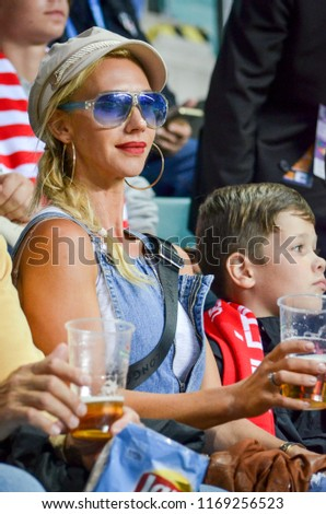 TALLINN, ESTONIA - 15 August, 2018: Fans girl of Atletico Madrid in the stands support the team during the final 2018 UEFA Super Cup match between Atletico Madrid vs Real Madrid, Estonia #1169256523