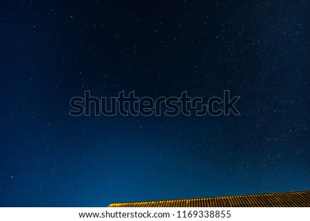 rooftop and stars on night sky #1169338855