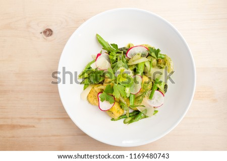 Plate of gnocchi with pesto with fresh local greens. #1169480743