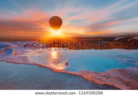 Hot air balloon flying over spectacular pamukkale - Natural travertine pools and terraces in Pamukkale. Cotton castle in southwestern Turkey, #1169500288